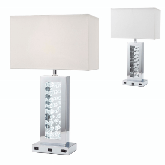 The Monica Table Lamp product image. It features a usb port and AC port on the base of the lamp for all of your charging needs as well as a beautiful mirror finish.